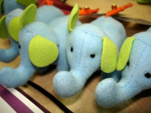 Little cute elephants, waiting in line to go to their new owners