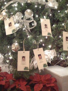 Little orphans putting their Christmas wishes on the tree...aged from 6 to 12.