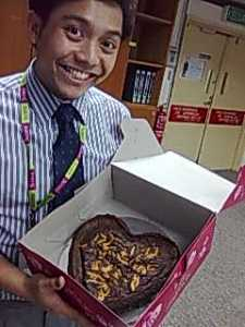Azlan and the brownie he baked - one of his specialities. To order, drop me a note.