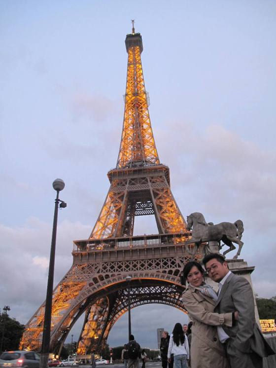 Trying to hide our frozen look - Romantic Eiffel at Dusk