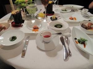 Part of our entree` - A feast on the senses. You are advised to start with the Tomato puree thingy (center) and work round clockwise to finish the 5 dishes. I cannot remember what they all are, but the flavours are wild!