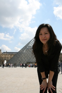 Yours truly indecently blocking the view of the entrance to the Musee de Louvre (Louvre Museum)