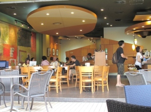Starbucks Gurney Plaza: Vern and I had sat on one of the wooden tables inside, 2nd row from the entrance.
